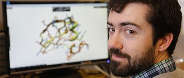 UW biochemistry graduate student and puzzle designer Brian Koepnick works in Foldit.